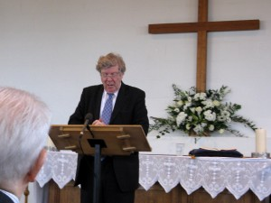 David Silcox giving Announcements & leading Hymns