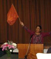 Portia waving worship flag