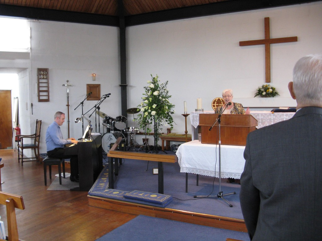 Sue Ann leads hymns in Watford-David Brace at piano