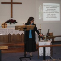 Nancy leading hymns on powerpoint