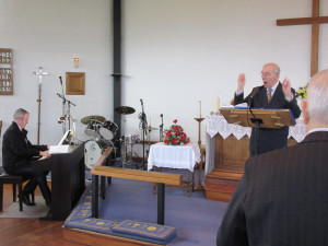 2015-02-14 George leading hymns with David Brace playing piano