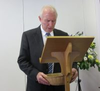 winston-bothwell-asks-the-blessing-over-the-offering