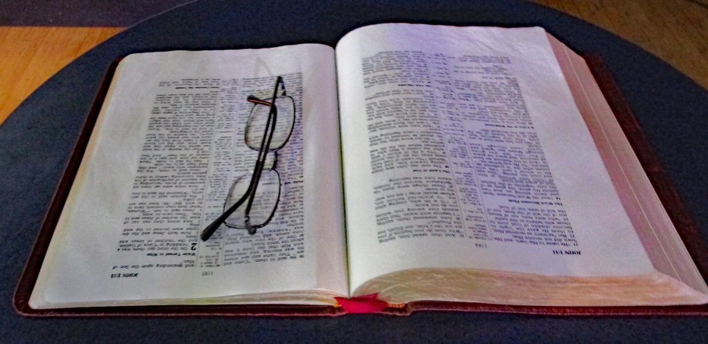 This image has an empty alt attribute; its file name is Bible-Glasses-1024x498.jpg