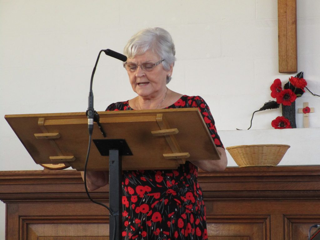 This image has an empty alt attribute; its file name is 2018-11-10-Watford-Remembrance-Service-Irene-Wilson-reads-of-poppies-1024x768.jpg